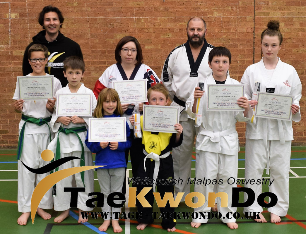 Malpas Tae Kwon Do students receiving their new belts and certificates from the last colour belt grading.